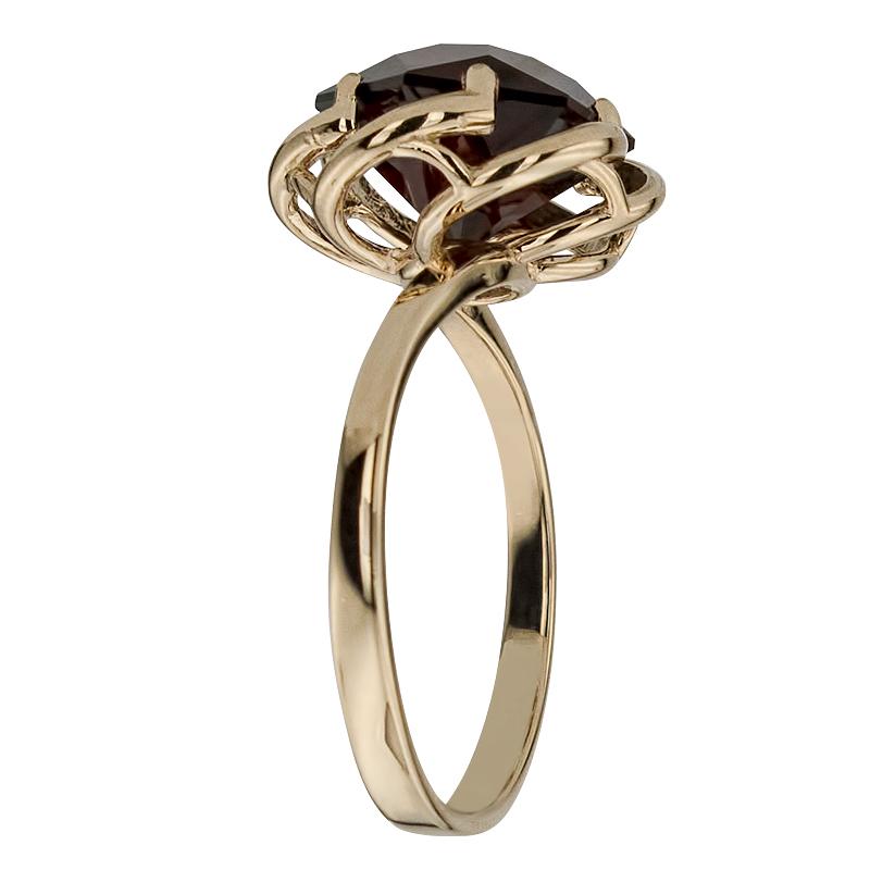 золотые кольца с камнем гранат фото